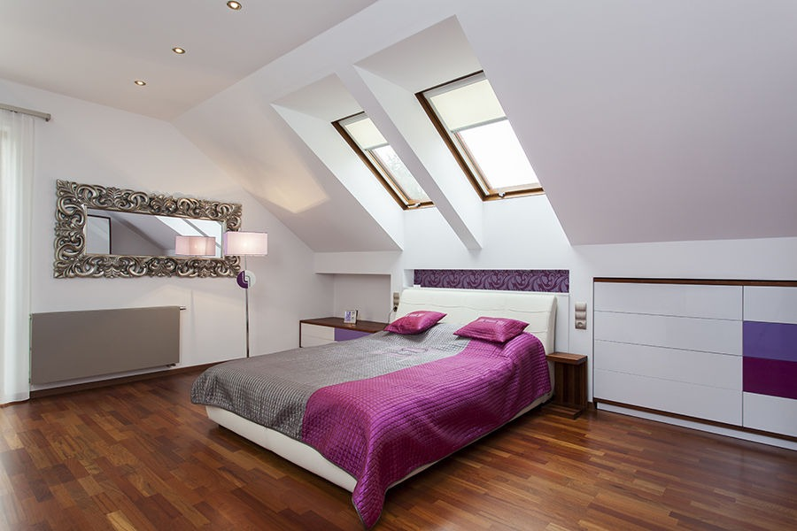 Modern bedroom in the attic of contemporary house