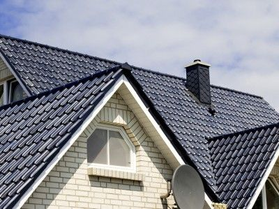 Tile roofing and shake gable details on a new home